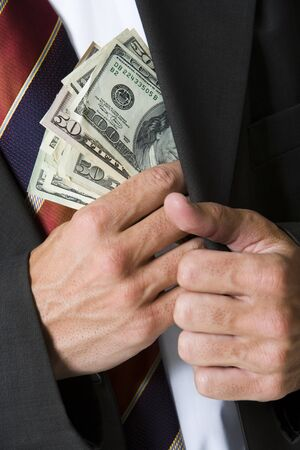 Mid Section View Of A Businessman Putting Money In His Pocket LANG_EVOIMAGES