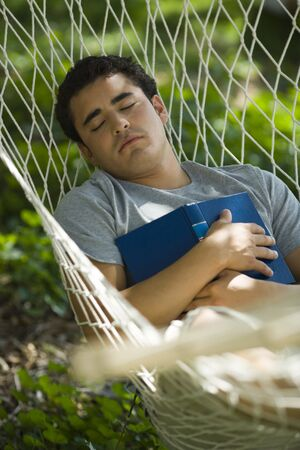 High Angle View Of A Young Man Sleeping In Hammock LANG_EVOIMAGES