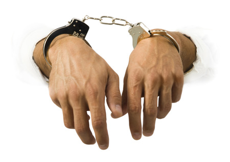 restraints: Close-Up Of Hands In Handcuffs LANG_EVOIMAGES