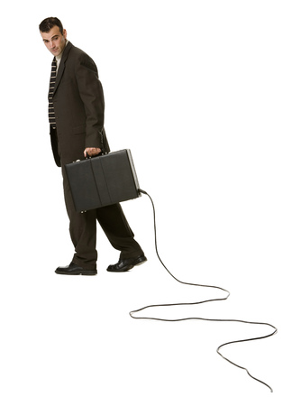Portrait Of A Businessman Holding A Briefcase With An Electrical Cord LANG_EVOIMAGES