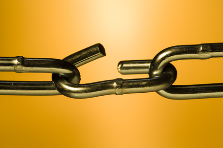 Close-Up Of A Broken Link In A Chain