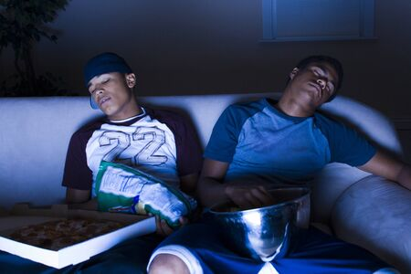 Young Men Asleep In Front Of The Tv LANG_EVOIMAGES