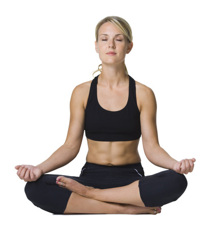Young Woman Doing Yoga With Her Legs Crossed