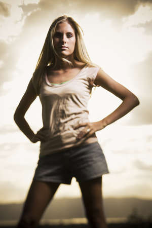 Young Woman Standing With Her Hands On Her Hips LANG_EVOIMAGES