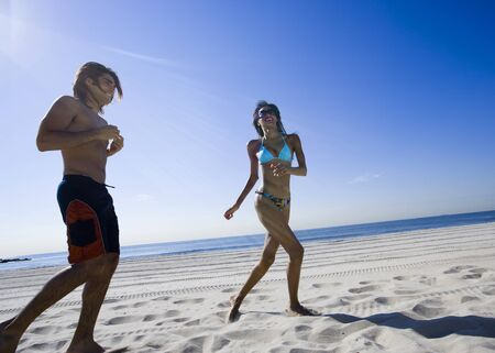 pursuing: Young Couple Running On The Beach