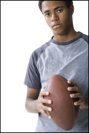 Portrait Of A Teenage Boy Holding A Football LANG_EVOIMAGES