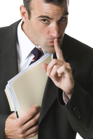 Portrait Of A Businessman Hiding A File