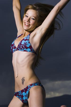Profile Of A Young Woman In A Bikini