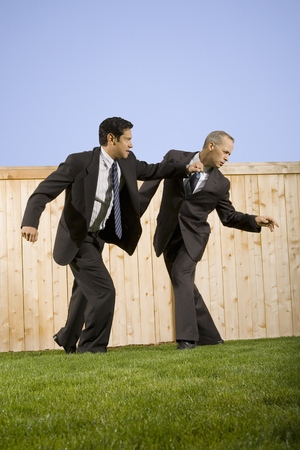 Low Angle View Of Two Businessmen Playing And Rough Housing
