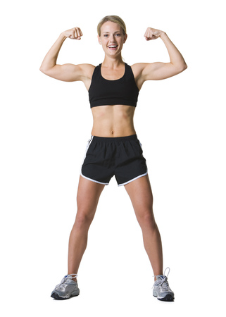 Portrait Of A Young Woman Flexing Muscles