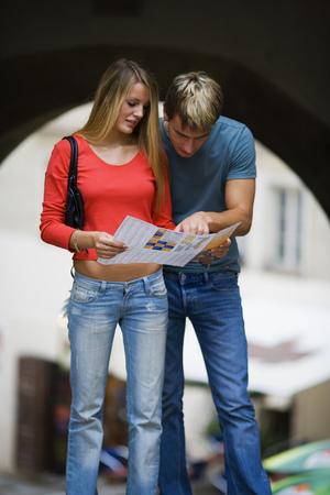 honeymooner: Teenage Couple Looking At A Map