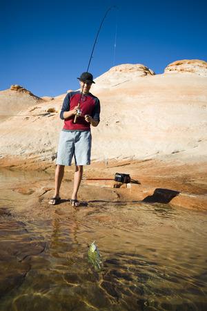 flip flops: Young Man Fishing LANG_EVOIMAGES