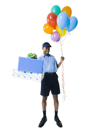 Portrait Of A Delivery Man Holding Gifts And Balloons LANG_EVOIMAGES