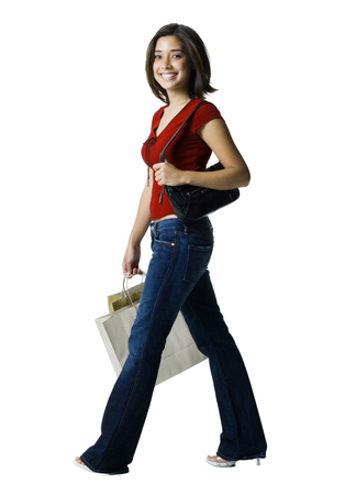 customer facing: Portrait Of A Young Woman Carrying Shopping Bags