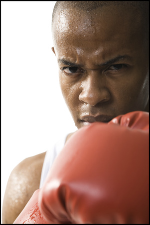 Portrait Of A Young Man Wearing Boxing Gloves