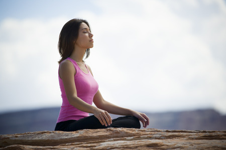 Profile Of A Young Woman Meditating LANG_EVOIMAGES
