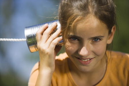 Portrait Of A Girl Listening Into A Tin Can Phone