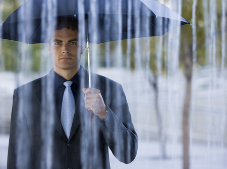 Portrait Of A Businessman Holding An Umbrella In The Rain