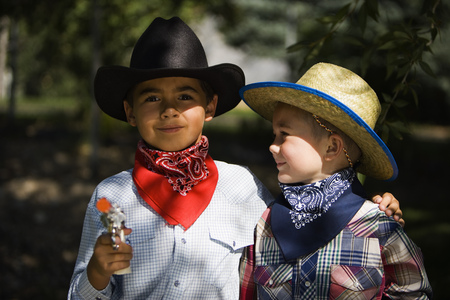 Portrait Of Two Boys In Cowboy Costumes