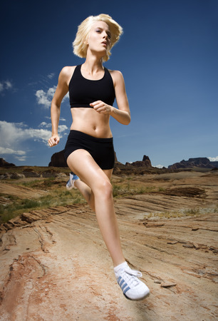 Low Angle View Of A Young Woman Jogging LANG_EVOIMAGES