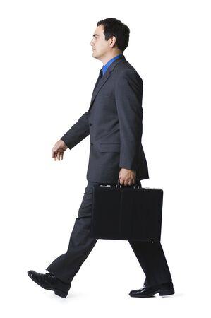 Portrait Of A Businessman Carrying A Briefcase LANG_EVOIMAGES