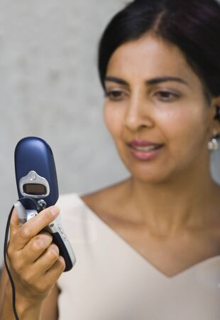 handsfree telephones: Close-Up Of A Businesswoman Looking At A Mobile Phone