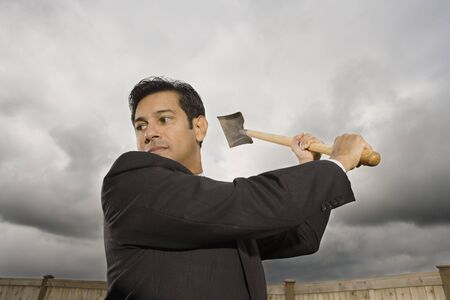 down beat: Low Angle View Of A Businessman Swinging A Shovel