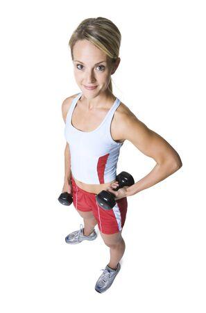 levantar peso: Vista de alto ángulo de una mujer joven que sostiene pesas de gimnasia LANG_EVOIMAGES