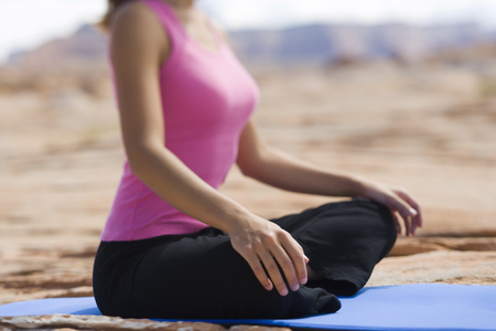 Mid Section View Of A Young Woman Meditating