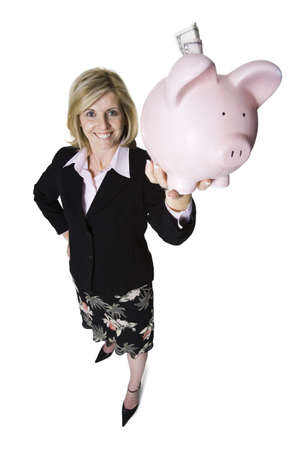 High Angle View Of A Businesswoman Holding Up A Piggy Bank