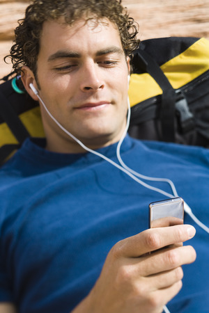 High Angle View Of A Young Man Listening To Music