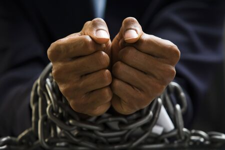 restraints: Man With Chains Around Wrists LANG_EVOIMAGES