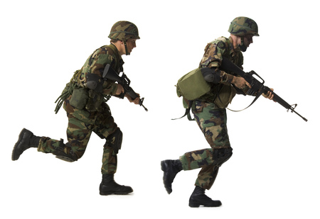 pursuing: Profile Of Two Soldiers Running With Their Guns LANG_EVOIMAGES