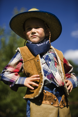 Low Angle View Of A Boy In A Cowboy Costume