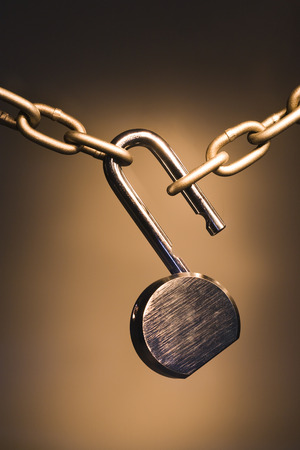 combination: Close-Up Of A Chain With An Open Padlock