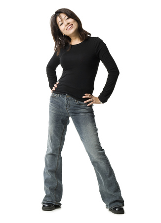 Portrait Of A Woman Standing With Her Hands On Her Hips LANG_EVOIMAGES