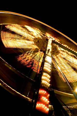 quickness: Low Angle View Of A Ferris Wheel Lit Up At Night