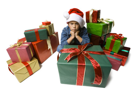 Portrait Of A Boy Sitting On The Floor With Presents Around Him