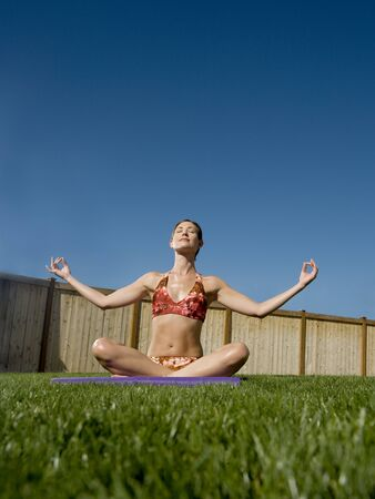 Low Angle View Of A Woman Meditating