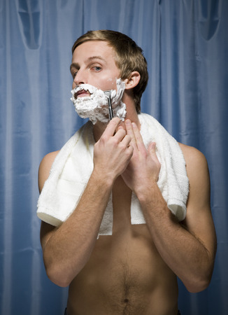 Close-Up Of A Young Man Shaving