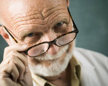 the elderly tutor: Portrait Of A Male Scientist Holding His Eyeglasses