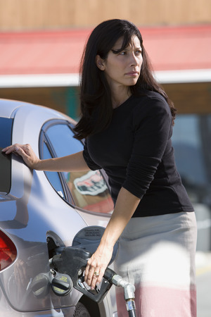 Woman Filling Her Car With Gas