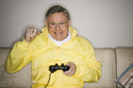 living room sofa: Close-Up Of A Senior Man Playing A Video Game