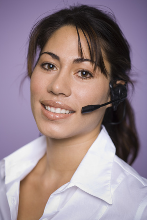 handsfree telephone: Portrait Of A Woman Wearing A Hands Free Device LANG_EVOIMAGES