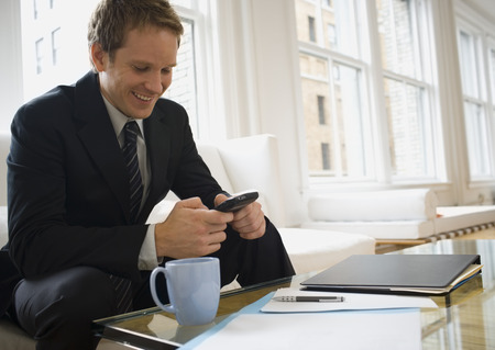 Businessman Operating A Mobile Phone