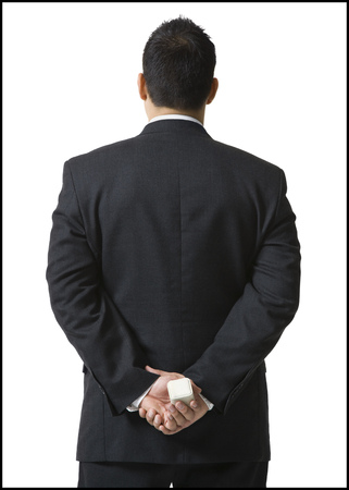 Rear View Of A Businessman Hiding A Jewelry Box Behind His Back LANG_EVOIMAGES
