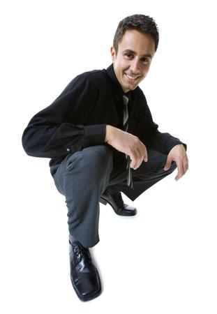 agachado: Retrato de un hombre de negocios sonriente