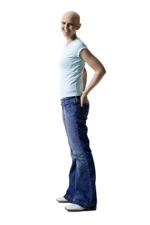 Profile Of A Bald Young Woman Standing With Her Hands In Her Pockets