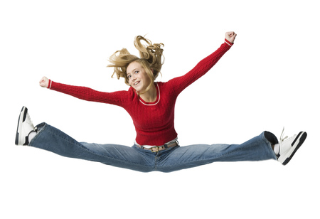 Portrait Of A Young Woman Jumping With Her Arms Outstretched LANG_EVOIMAGES