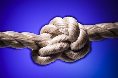 intertwined: Close-Up Of A Tied Knot On A Rope LANG_EVOIMAGES